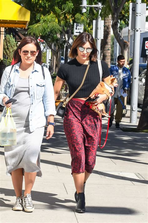 katharine mcphee wears a black crop top and red animal ...