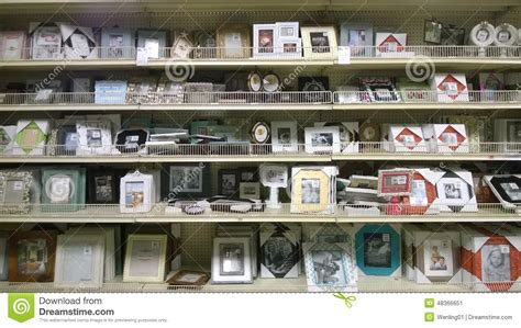 picture frames on shelves selling editorial photo