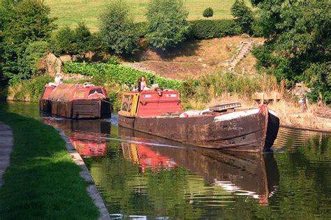 Canal Boat Cheshire by Historic Working Narrow Boats On The Macclesfield Canal In