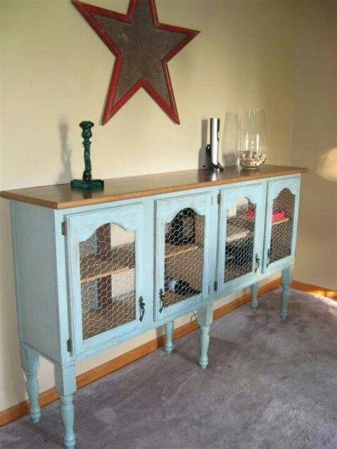 chicken wire kitchen cabinets add legs and a chicken wire and cabinet drawers 5387