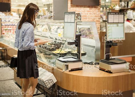 Young Woman Buying Grocery In Supermarket Stock Photo ...