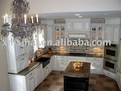 brown cabinets with white countertops tropical brown granite white cabinets dark tile floor