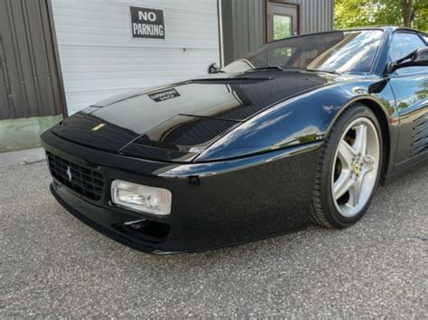 Finished in rosso corsa over black interior, it is truly stunning and looks bra. 1992 Ferrari 512 TR - Black on Tan — luxury vehicle For ...