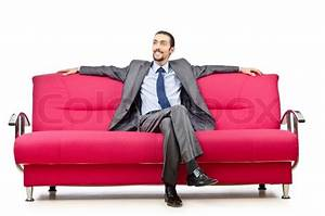 Man sitting in the sofa | Stock Photo | Colourbox