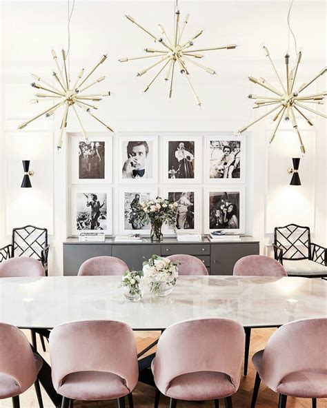 The buffet table for brunch features a large porcelain urn with a flower arrangement of hydrangeas and roses. Photo gallery wall behind dinner table + buffet underneath   Dining room wall decor, Dining room ...