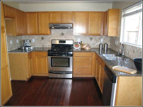 kitchen cabinets with light wood floors wood floors