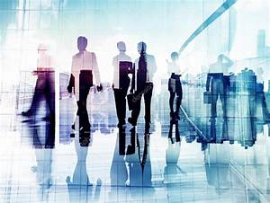 Silhouettes of Business People in Blurred Motion Walking ...