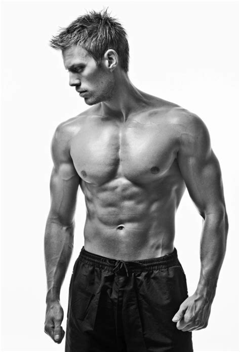 a young and fit male model posing his muscles – Pouted