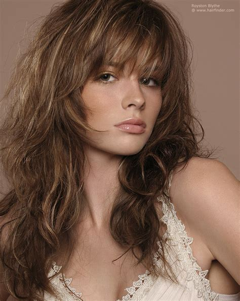 long hair layered haircut long layered haircut with highlights and styled with ruffing