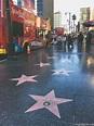Walking along Walk of Fame on Hollywood Boulevard Los ...
