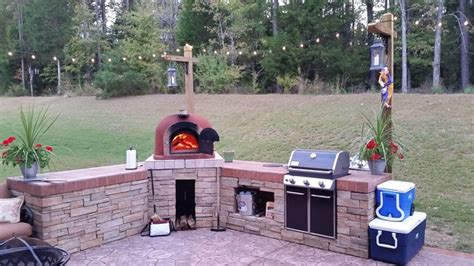 outdoor kitchen  wood fired pizza oven gas grill
