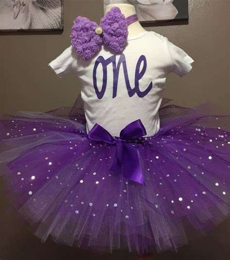 Rompers or onesies can also be worn on their first birthday if the theme decided by you for the birthday celebration is to look informal and funky. First birthday tutu set with onesie. Made by me.