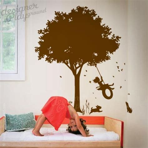 girl swinging  tree