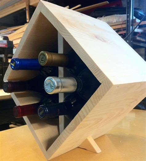 hand   bottle table top triangle wooden wine rack