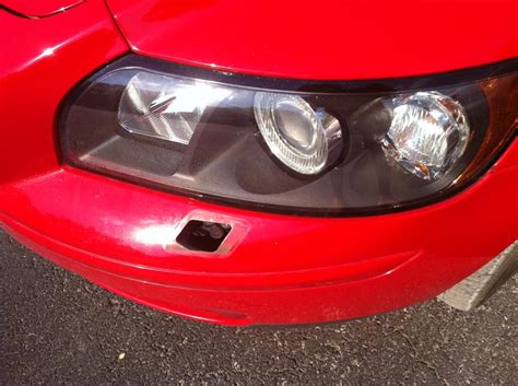broken headlight washer cover  replacement volvo