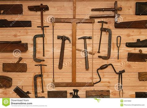 hanging tools on wall ancient carpenter tools on a wooden wall stock photo 4145