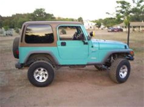 white and teal jeep trail ready 1998 aqua blue with 92k miles 5 speed manual