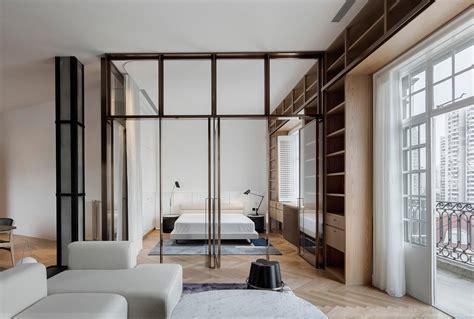 shanghai apartment lined  floor  ceiling bookshelves