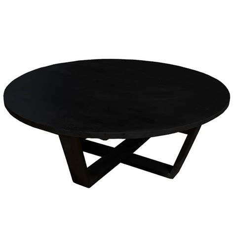 Modern coffee tables contain different materials such as glass, acrylic wood etc and some of the tend to be much easier to maintain and require almost no care. Coffeephile Black Solid Wood Round Coffee Table