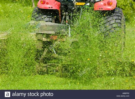 Cutting Grass With Tractor And Industrial Grass Cutting