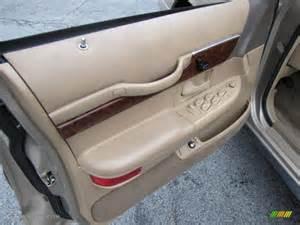 1997 mercury grand marquis ls light prairie tan door panel