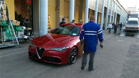 striking red alfa romeo giulia  photographed