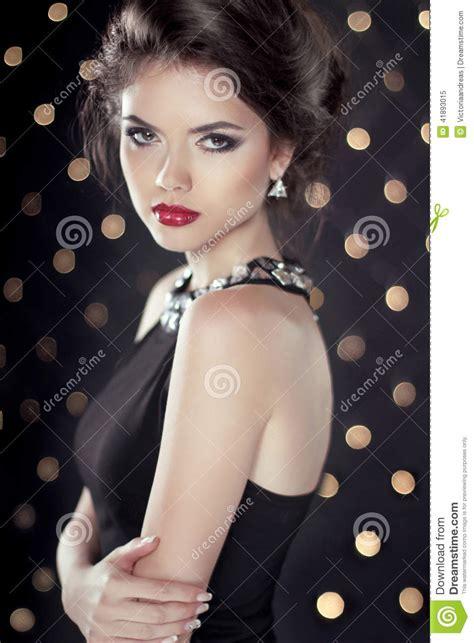 fashion beauty glam brunette girl model over bokeh lights