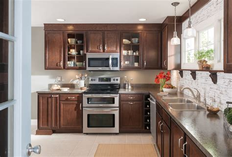 warm dark brown wood kitchen cabinets kitchen