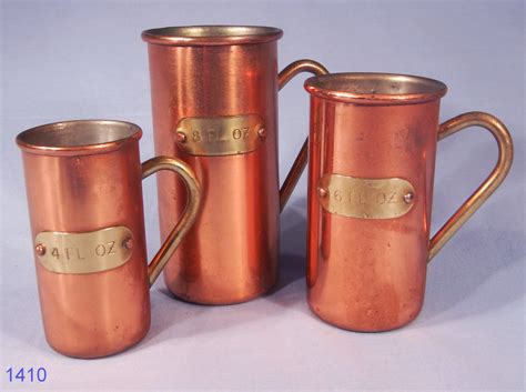 set   copper measures tin lined  brass handles sold collectable china