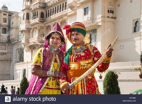 elderly couple wearing traditional costumes city palace