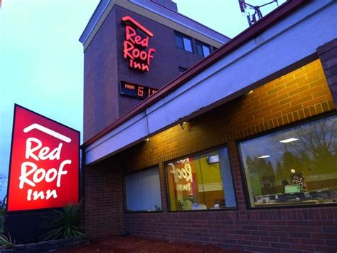 Picture Of Red Roof Inn Seattle Airport Metal Roof Cleaning Jacksonville Fl Wood Trusses Specifications Baker Roofing Roanoke Virginia Roofers In Greenville Sc Sunroof Drain Clean Out Malarkey Shingles Drip Edge Yakima Megawarrior Rooftop Cargo Basket