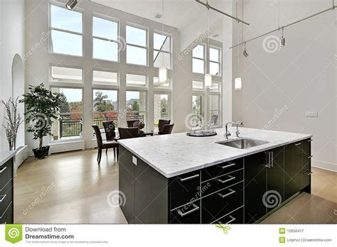 Modern Kitchen With Two Story Windows Stock Image   Image