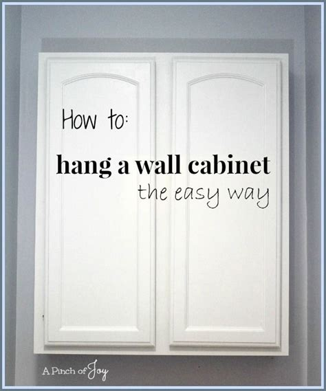 How To Hang A Bathroom Cabinet On The Wall by How To Hang A Wall Cabinet The Easy Way A Pinch Of
