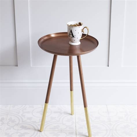 copper table  brass tipped legs    room