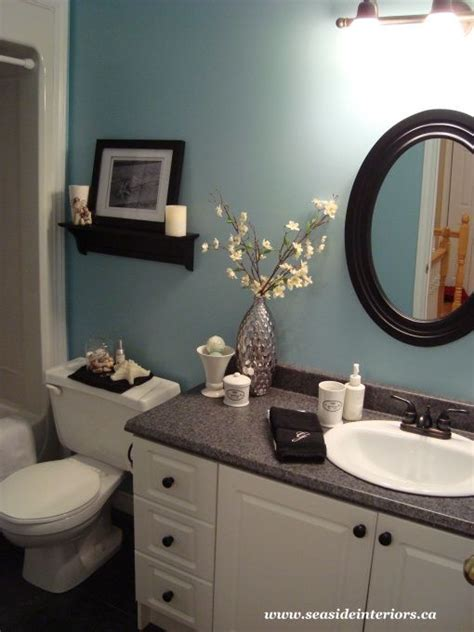 tranquil bathroom ideas the current paint color is tranquil blue by benjamin moore i love the black and white scheme of