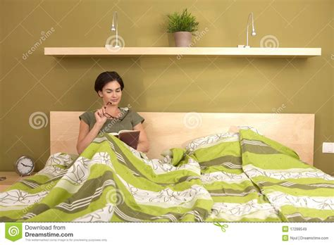 in bed reading book in bed stock image image of glasses