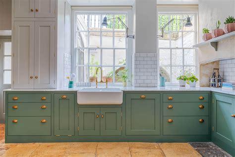 white shaker kitchen  brass sustainable kitchens