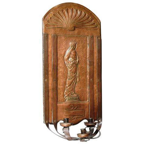 arts and crafts copper wall sconce attributed to a h