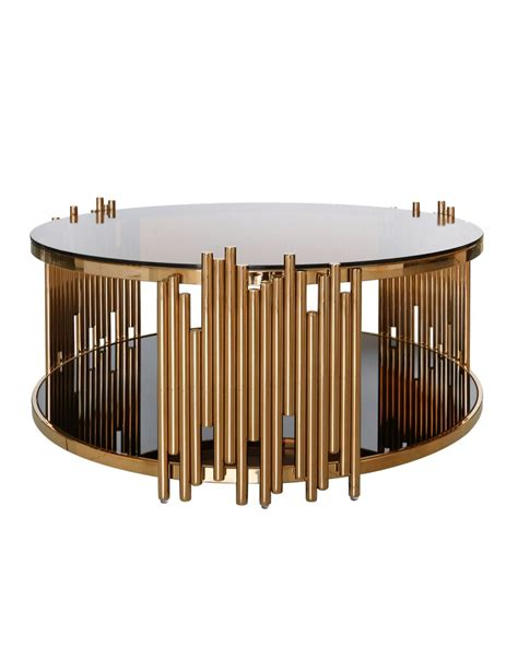 With effortless infusion of frosted glass and unique retro inspired rose gold metal base, this piece will naturally blend in your living room, making it a statement of any room decor. Moretz Rose Gold Round Coffee Table
