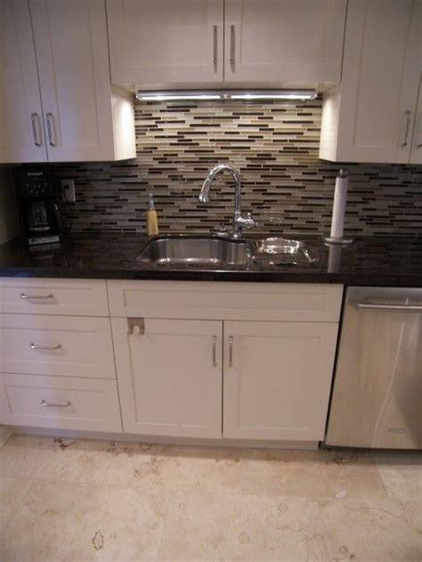 black kitchen countertops with backsplash white cabinets black countertop backsplash brings beige 7884