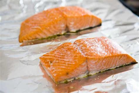 how to bake salmon baked salmon with avocado mango salsa recipe simplyrecipes com