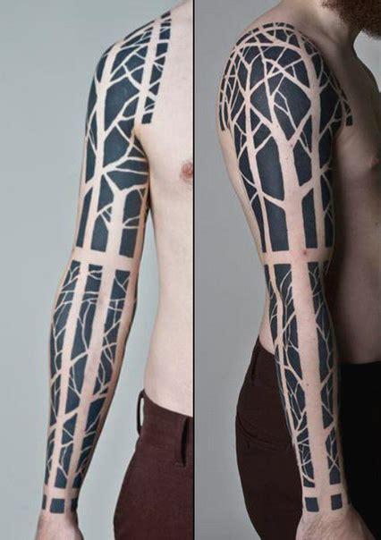 negative scary forest blackwork tattoo sleeve idea