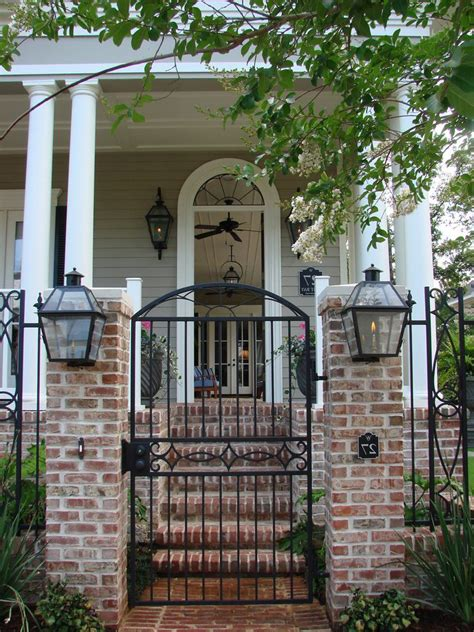 gates for front of house front entrance garden ideas landscape mediterranean with white stucco fence iron gate iron gate