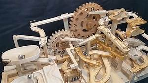 A Wooden Marble Machine Uses Gears and Lifts to Endlessly