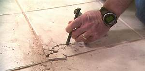 How to remove and replace a damaged ceramic tile today39s for Cracked bathroom tile repair