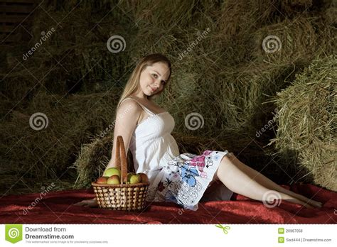 Girl Sits On Hay In The Barn Royalty-free Stock Image
