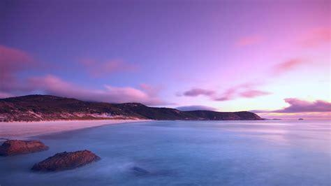 night sea ocean water surface  beach purple sky clouds