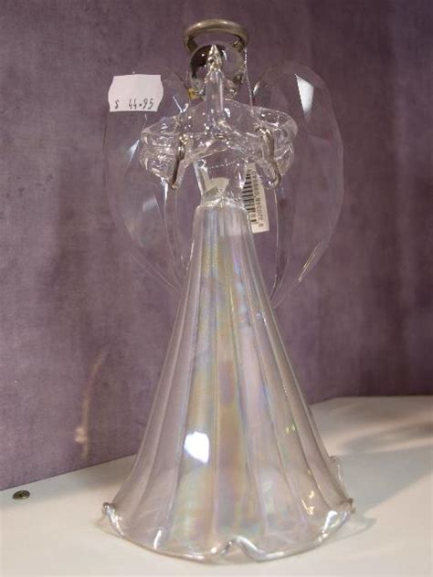glass angel holding  candle christmas