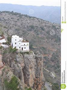 House On The Edge Of The Cliff Stock Photo
