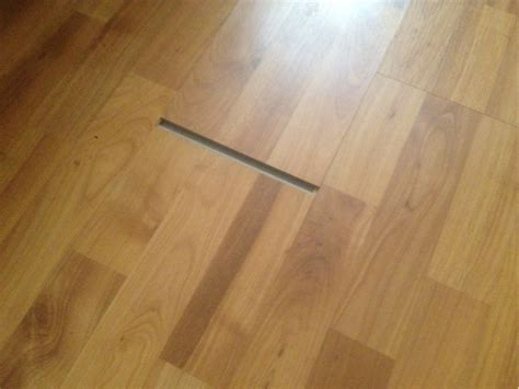 vinyl plank flooring shrinkage repair laminate floor sliding out of place home improvement stack exchange